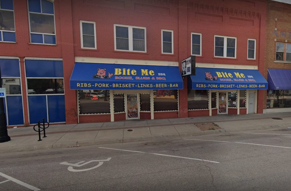 Wichita's Bite Me BBQ bumbles inspection; 12 violations, soap container on the bar warewashing machine was empty. Multiple loads of glassware had been washed