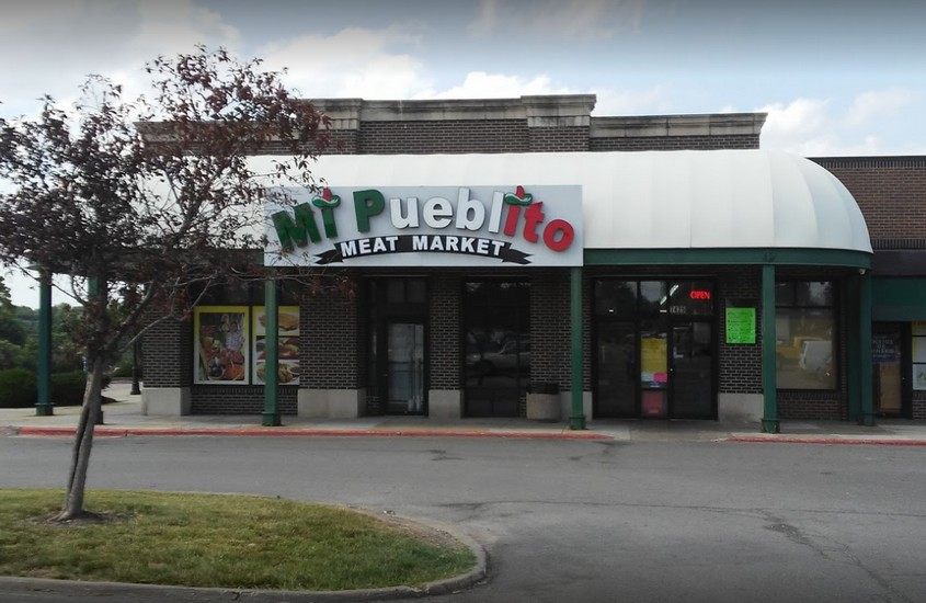 Complaint inspection at Mi Pueblito Meat Market in Shawnee finds undated food, expired food, slicer stored as clean had dried food debris along the blade