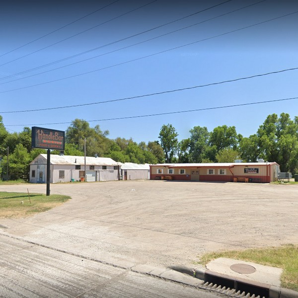 Handle Bar and Grill in Great Bend fouls inspection; Cooked hamburger patties in broth in a metal pan in temperature danger zone